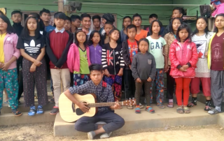 kids from India receive guitar from Hear The Hope