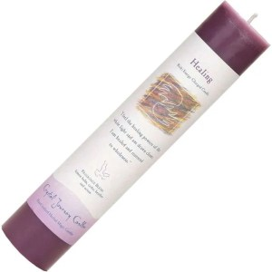 Purple pillar candle, seven inches high, one and one half inch diameter.