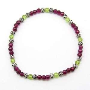 Garnet and peridot 4mm bead bracelet.