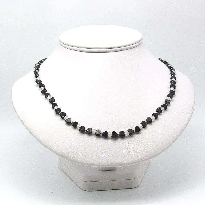 "20"" black onyx heart and round snow quartz bead necklace."