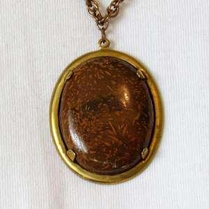 Chrysanthemum cabochon pendant antique gold detail