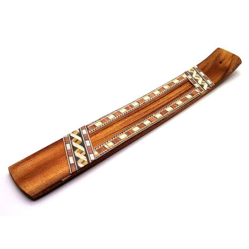 Geometric pattern wood incense burner.