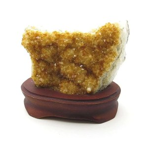 Citrine crystal specimen on wooden base.