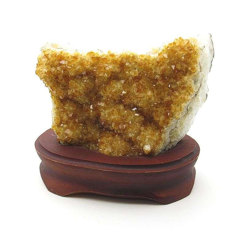 Citrine crystal specimen on wooden base.