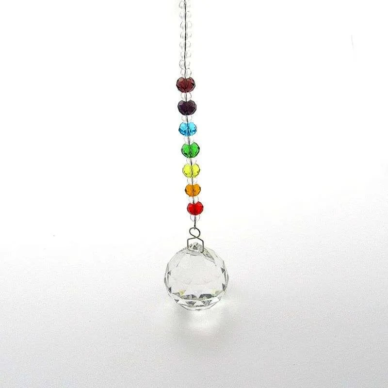 Small faceted crystal with chakra crystals on chain.