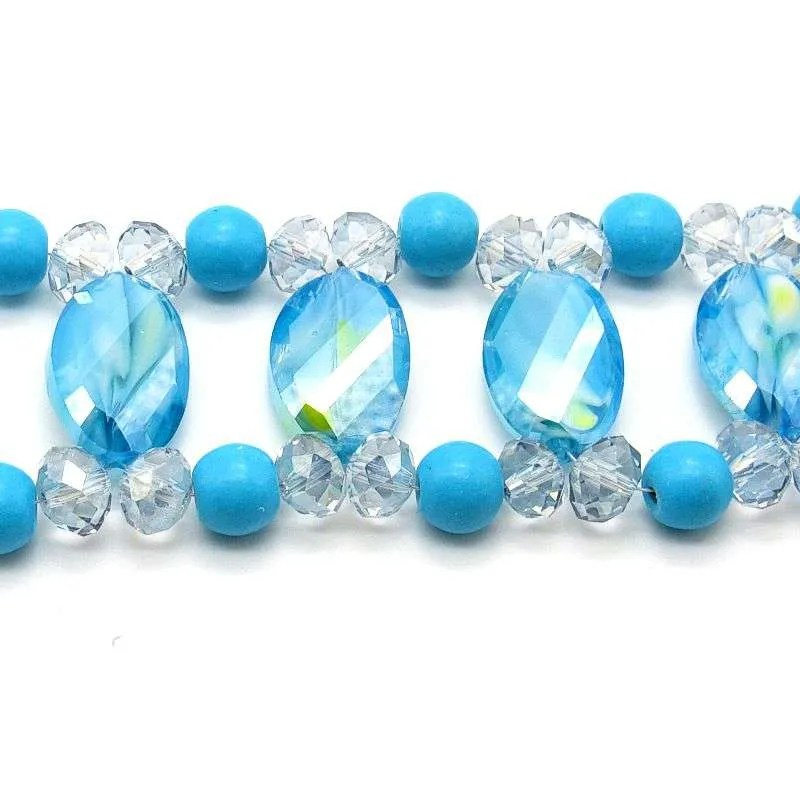 Swirling blue glass beads accentuated with blue dyed magnesite.