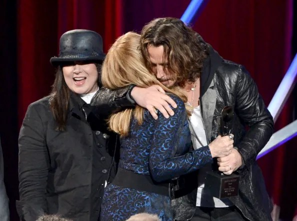 LOS ANGELES, CA - APRIL 18: (L-R) Inductees Ann Wilson and Nancy Wilson of Heart and presenter Chris Cornell speak onstage at the 28th Annual Rock and Roll Hall of Fame Induction Ceremony at Nokia Theatre L.A. Live on April 18, 2013 in Los Angeles, California.  (Photo by Kevin Winter/Getty Images)
