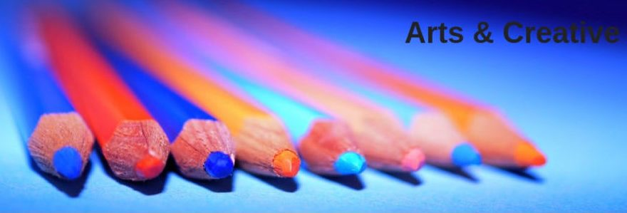 Arts and Creativity - A row of coloured pencils on a blue background