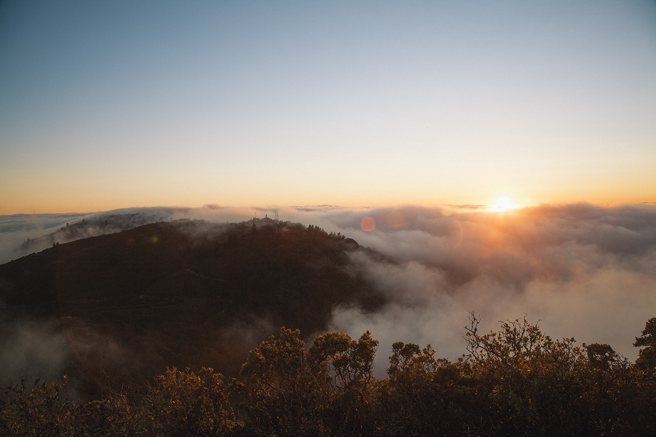 Sunrise over foggy hills