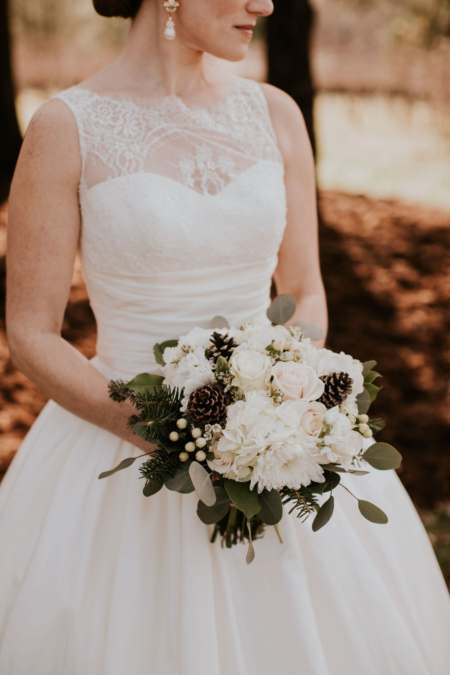winter wedding flowers - winter bridal bouquet - bouquet with pinecones