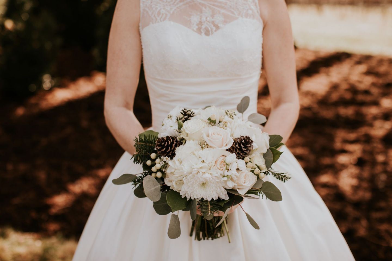 winter wedding flowers - winter bridal bouquet - bouquet with pinecones
