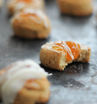 Almond Apricot Thumbprint Cookies are a gluten-free, but full-flavored, treat every cookie lover will enjoy. Drizzled with white chocolate, these goodies are perfect for the holidays!
