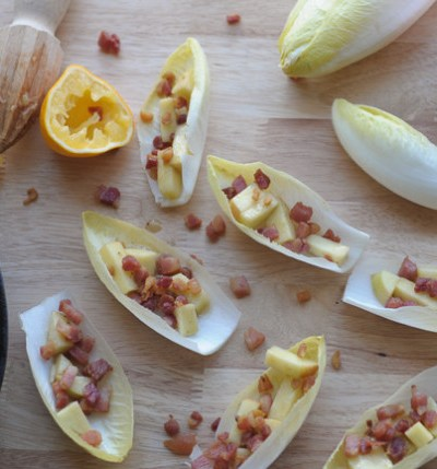Endive boats with pancetta, apples and Meyer lemon vinaigrette.