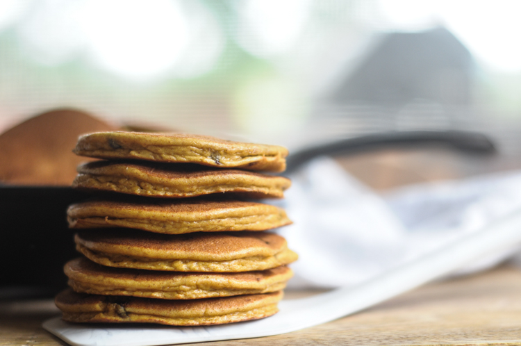 Grain Free Pumpkin Chocolate Chip Pancakes are simple to make and incredibly delicious! Serve these pancakes warm, with grass-fed butter and, for a real treat, a drizzle of pure maple syrup! @heathersdish