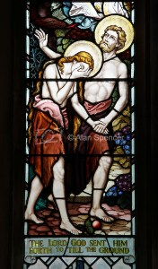 Stained glass window of expulsion from Eden