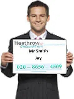 Young Man Holding Heathrow Gatwick Cars Placard Harlow to Gatwick Airport