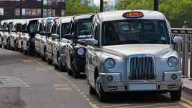 Taxis parked in London Airport - how to get from heathrow to stansted airport