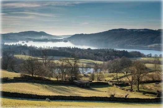 Morning mist over Windermere Lake