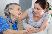 caregiver-helping-elderly-woman-350