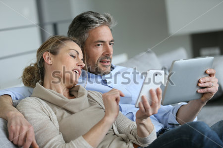 Shutterstock couple browsing devices