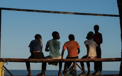 Boys watching Football on the beach