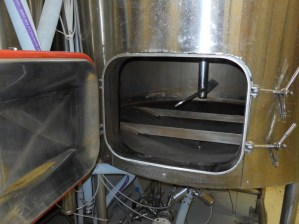 The paddle in the mash tun mixes the barley and water.