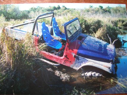 82 jeep scrambler stuck in mud