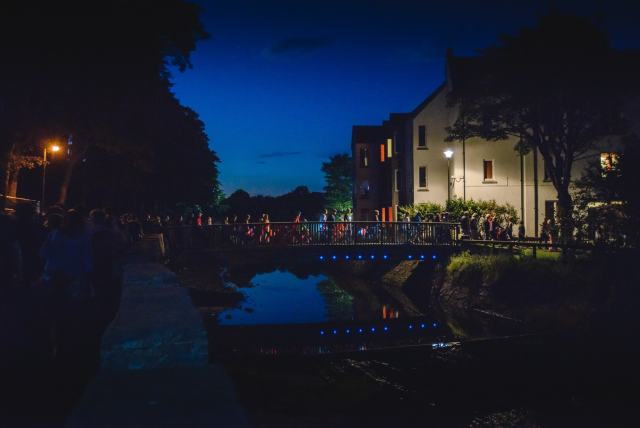 HebCelt fans walk over YM bridge in Stornoway at night