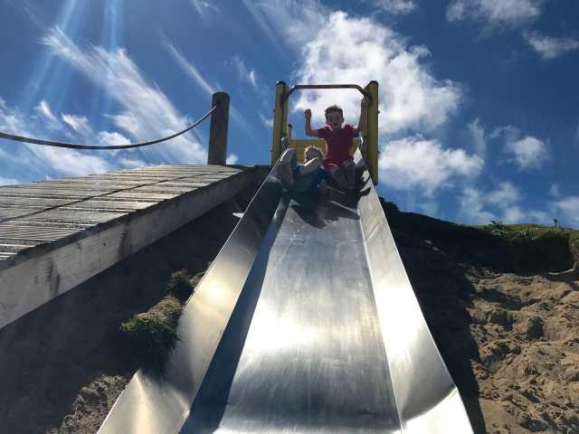 Children on slide at play park