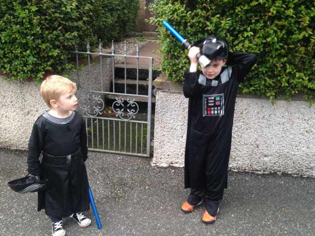 Boys in Star Wars costumes