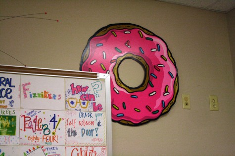 Kuhn's doughnut on the wall helps to reflect his humorous character.