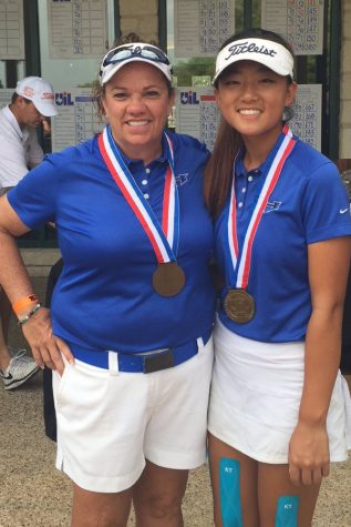 Park poses with girls golf coach Terie Campbell after completing her memorable round.