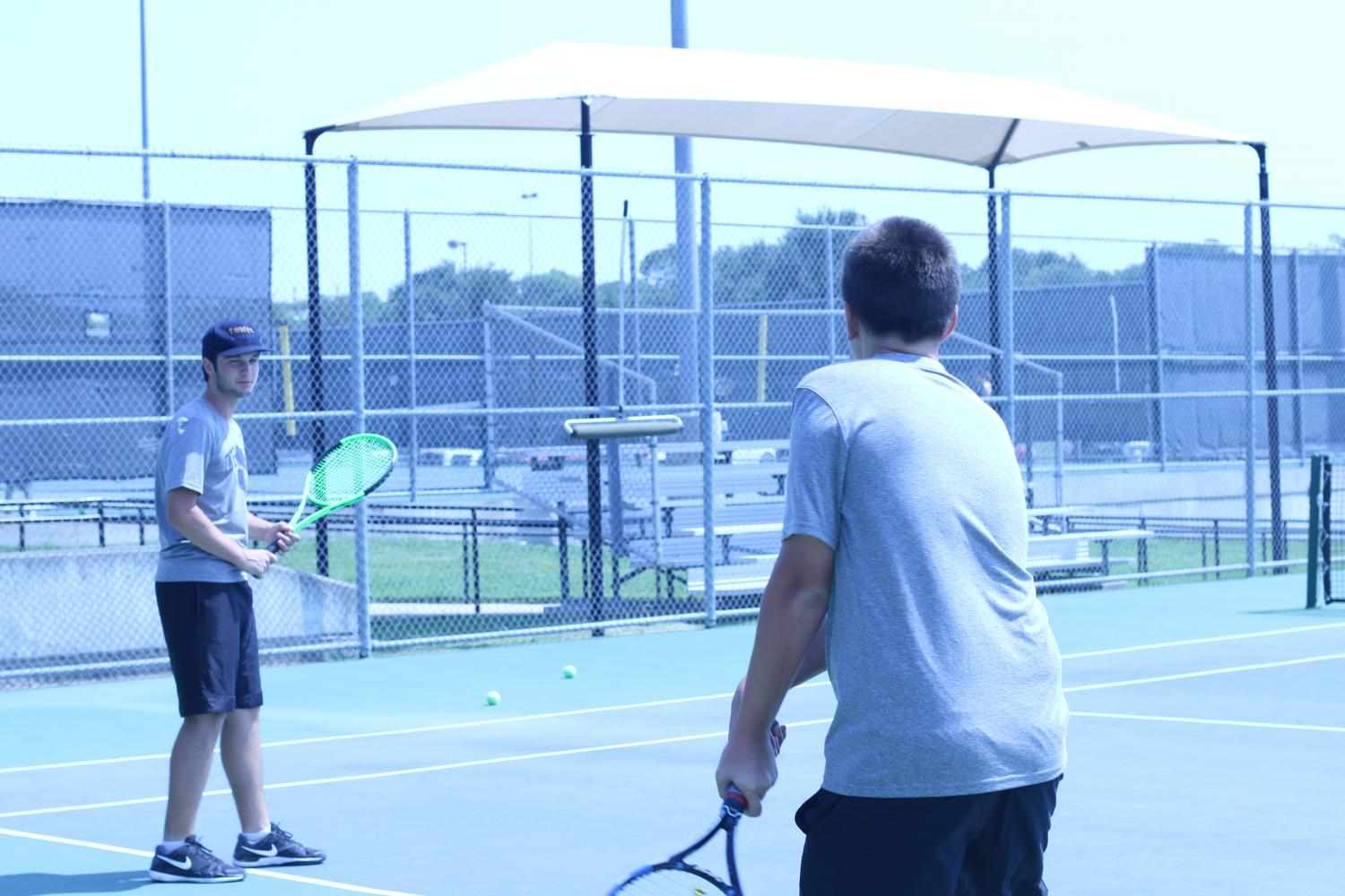 Tennis practices before heading to a tournament. Varsity defeated Lewisville at an away game on Oct. 3.
