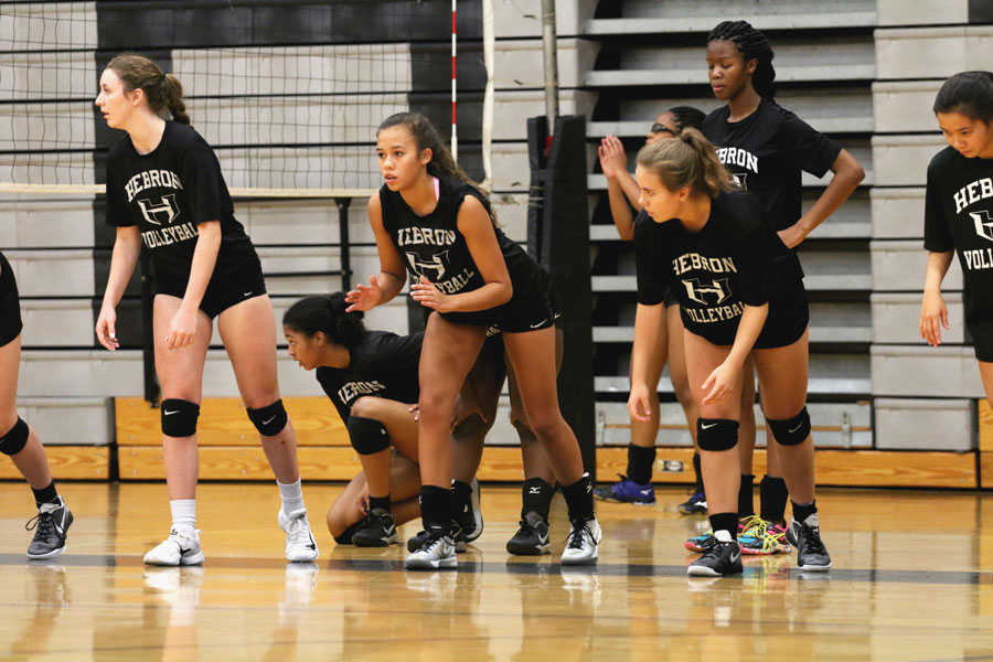 The+volleyball+team+prepares+to+run+sprints+as+they+warm+up+for+a+tough+practice.+They+play+Marcus+on+Friday.+
