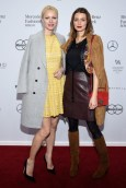 Franziska Knuppe und Eva Padberg besuchten die Show von DIMITRI auf der Mercedes-Benz Fashion Week Berlin (Photo by Clemens Bilan/Getty Images)