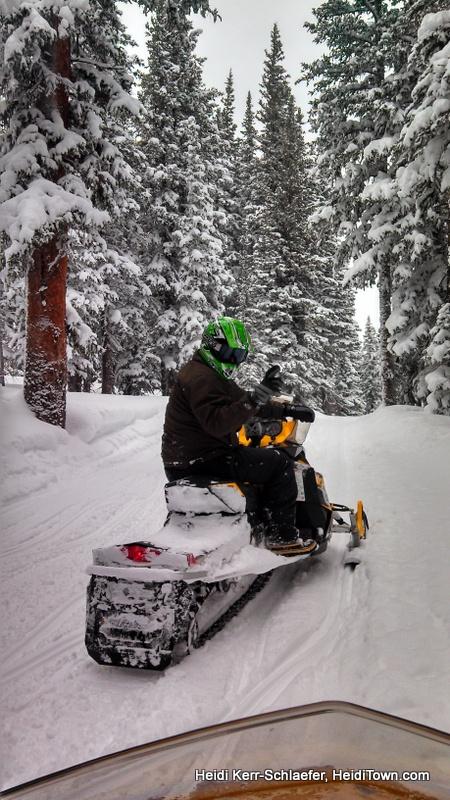 Ryan & Heidi snowmobiling grand county heiditown