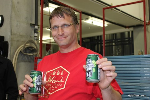 Ryan holding our fresh cans of Modus Hoperandi IPA at Ska Brewing in Durango. HeidiTown.com