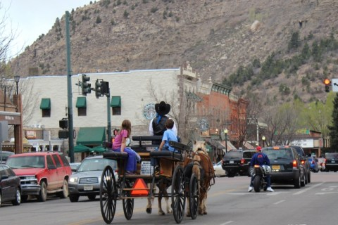 Dean taking some local kids home by carriage in Durango, Colorado. HeidiTown.com