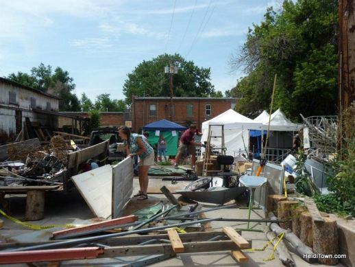 artists going through the junk pile at The Sculpture Games in 2012. HeidiTown.com