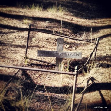 a cross marker indicates a gravesite at the Leadville Cemetery. heidiTown.com