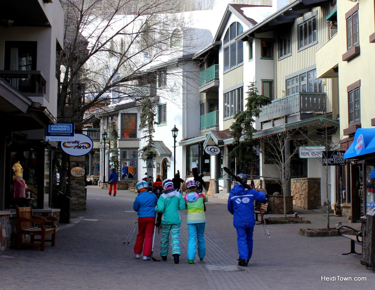 Skiers carry skis through Vail Village in Vail, Colorado. HeidiTown.com