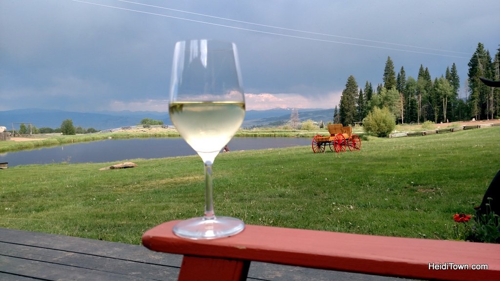 drinking a glass of wine at Latigo Ranch in Kremmling, Colorado. Six reasons to love Latigo Ranch. HeidiTown.com