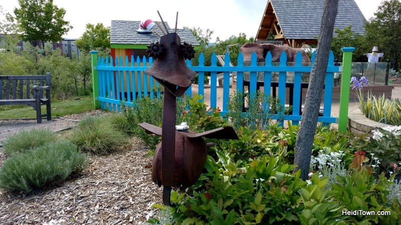 Flower Power in Fort Collins, a Visit to The Gardens on Spring Creek. sculpture in Children's Garden. HeidiTown.com