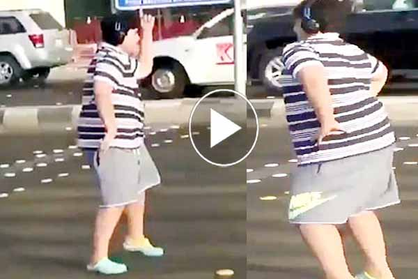 Saudi Arabia teenager stopped traffic starts dancing disrupted traffic police arrested boy video goes viral at social media.