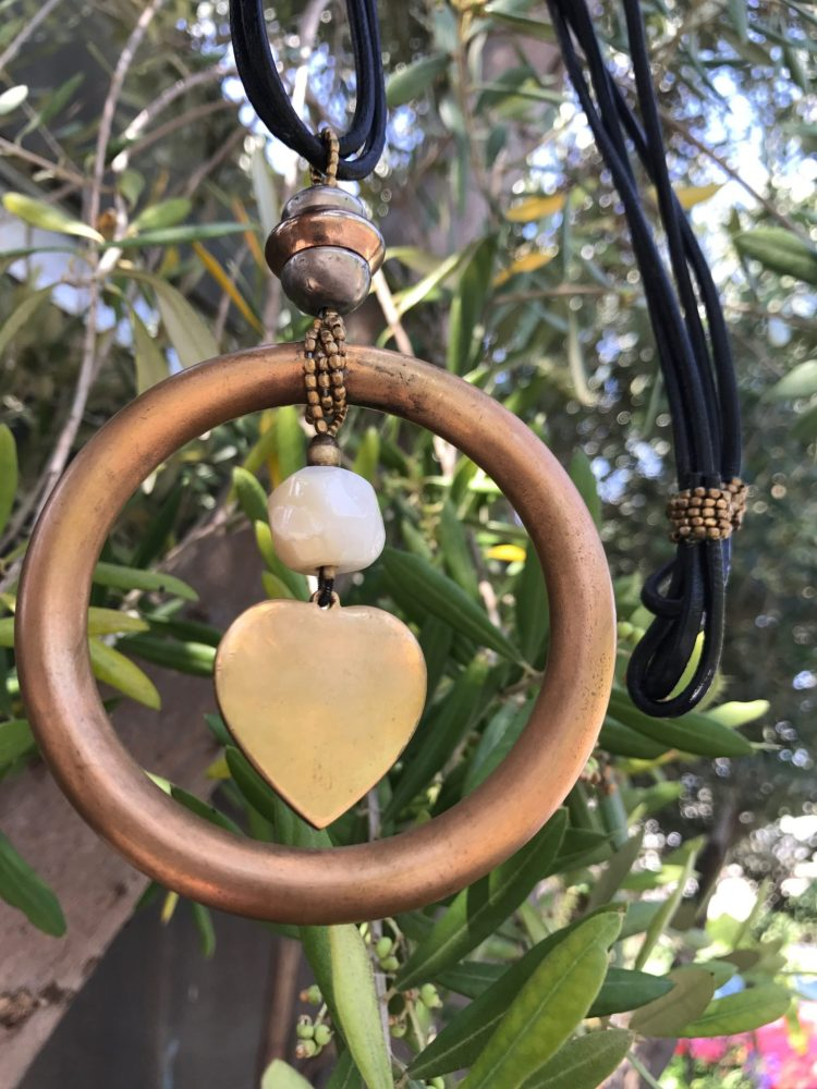 A Captured Heart – Single Strand Necklace With Pendant