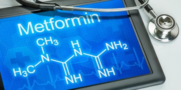 The chemical structural formula of metformin is displayed on a tablet.