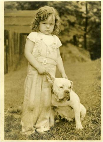 Rae Jean Sprigle poses with her bull dog, c. 1940. Gift of Rae Jean Kurland, MSS 779, Detre Library & Archives at the History Center.