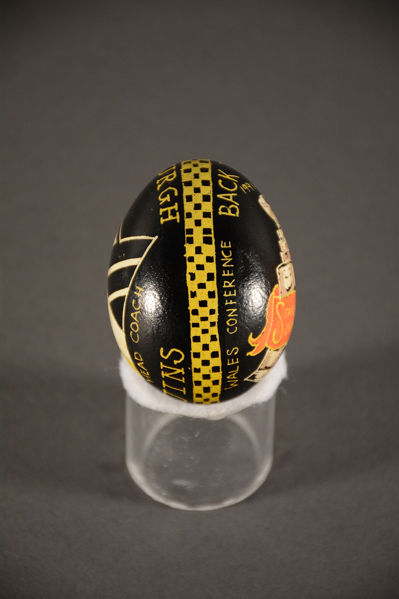 """This egg, done for Head Coach Scott Bowman shows the band that encircles each egg and represents """"the continuous thread of life."""" Gift of Pittsburgh Penguins"""