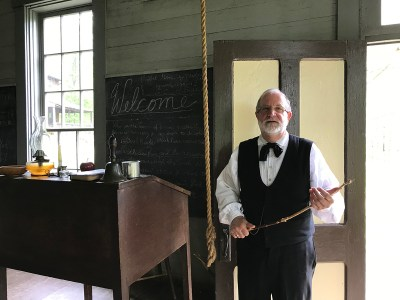 Schoolmaster Gary Ford in the one-room schoolhouse at Meadowcroft Historic Village.