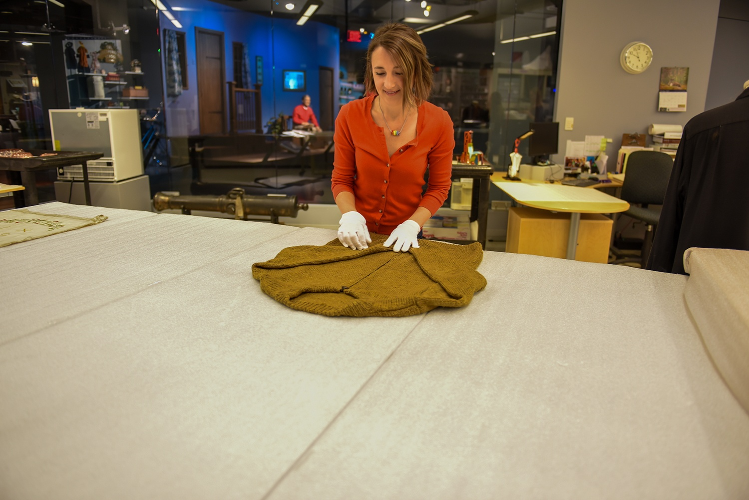 """Heinz History Center curator Emily Ruby prepares a handmade sweater owned by Fred Rogers to be added to the museum's popular """"Mister Rogers' Neighborhood"""" exhibit."""